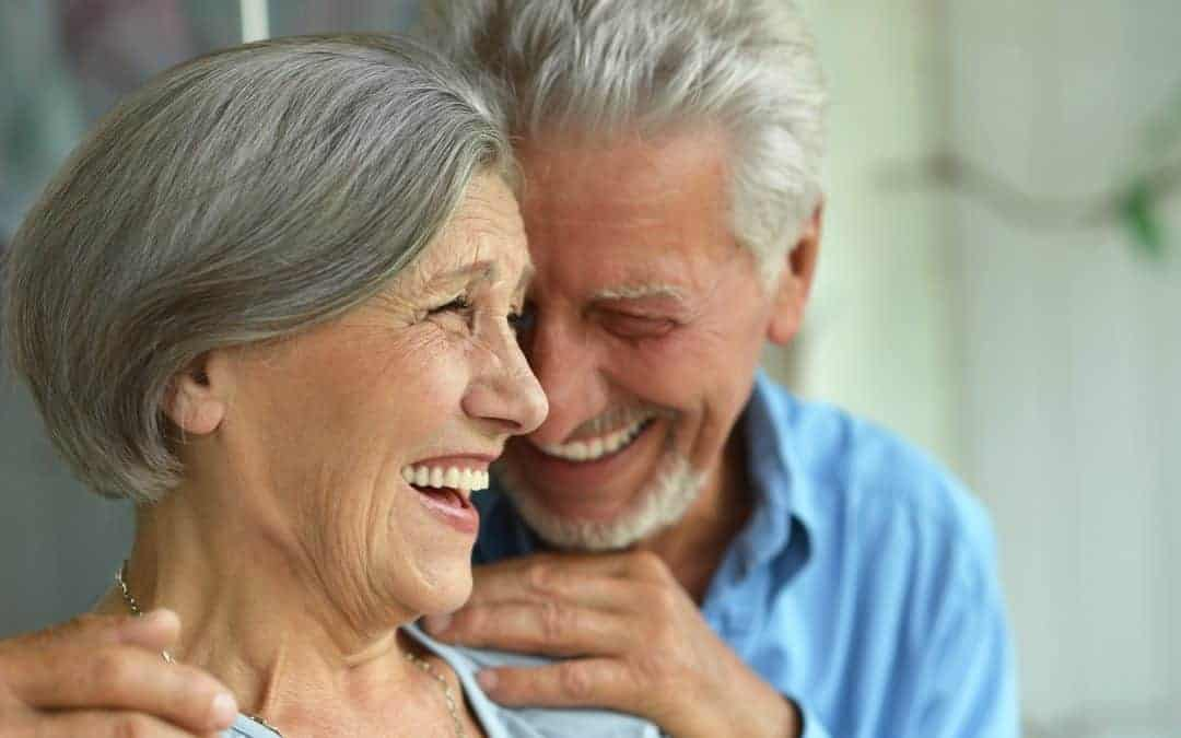 elder couple laughing together